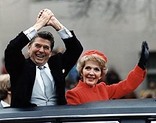 Ronald and Nancy Reagan wave from limo